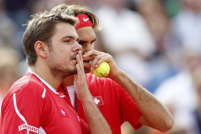 Roger Federer e Stanislav Wawrinka, impegnati nella semi finale di stasera che deciderà l'avversario di Djokovic