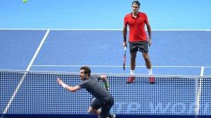 Andy Murray, intento a recuperare il loob di Roger Federer.